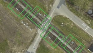 Back on track: locating assets on aerial images